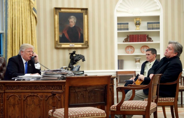 President Donald Trump in the Oval Office with his chief strategist Steve Bannon.